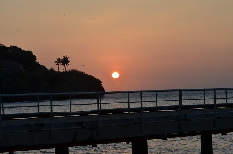 Setting sun christmas island over jetty